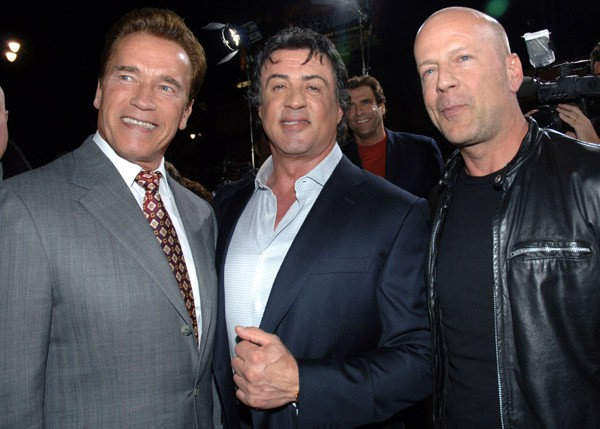 Sylvester Stallone and Arnold Schwarzenneger posing.