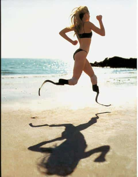 woman without legs running on the beach