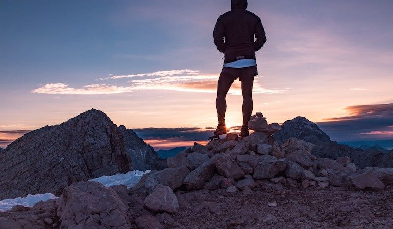 ways to reach your full potential, man on top of a mountain