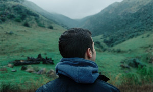 how to change your thoughts, man thinking and gazing at mountains
