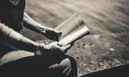 woman reading, read to achieve
